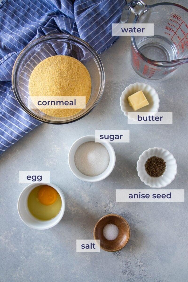 Cornmeal Fritters (Arepitas de Maiz) ingredients on a board