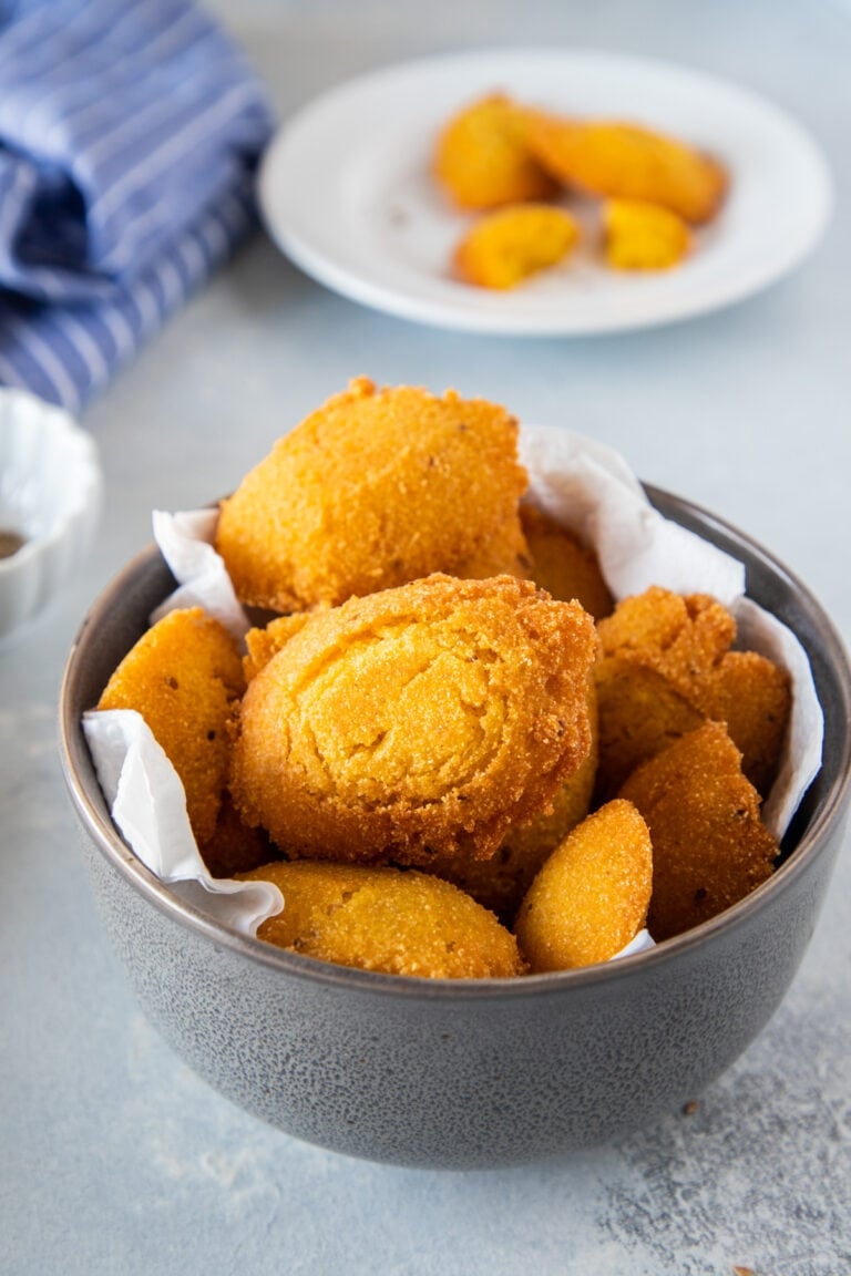 Cornmeal Fritters (Arepitas de Maiz) served in a gray bowl