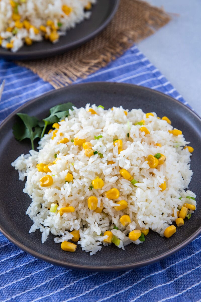 Rice with corn (arroz con maiz) served on a plate with forks on the side