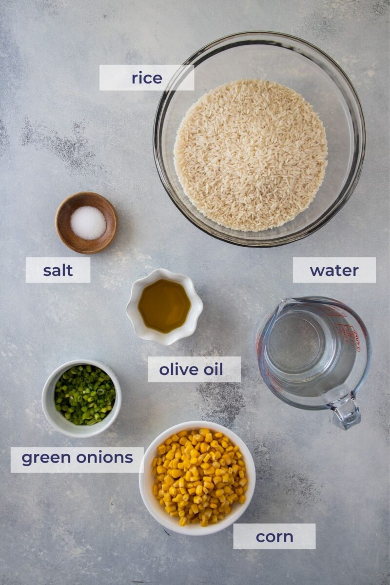 Rice with corn (arroz con maiz) ingredients on a board