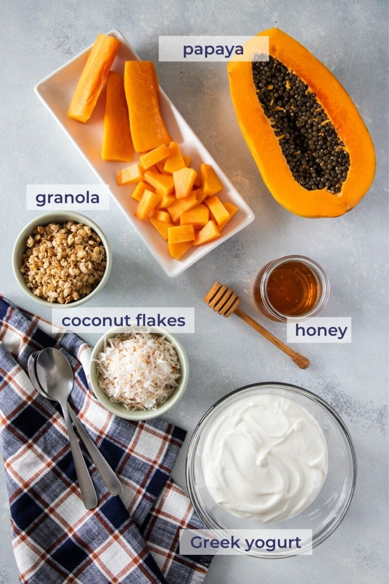 Papaya Yogurt parfait ingredients on a board