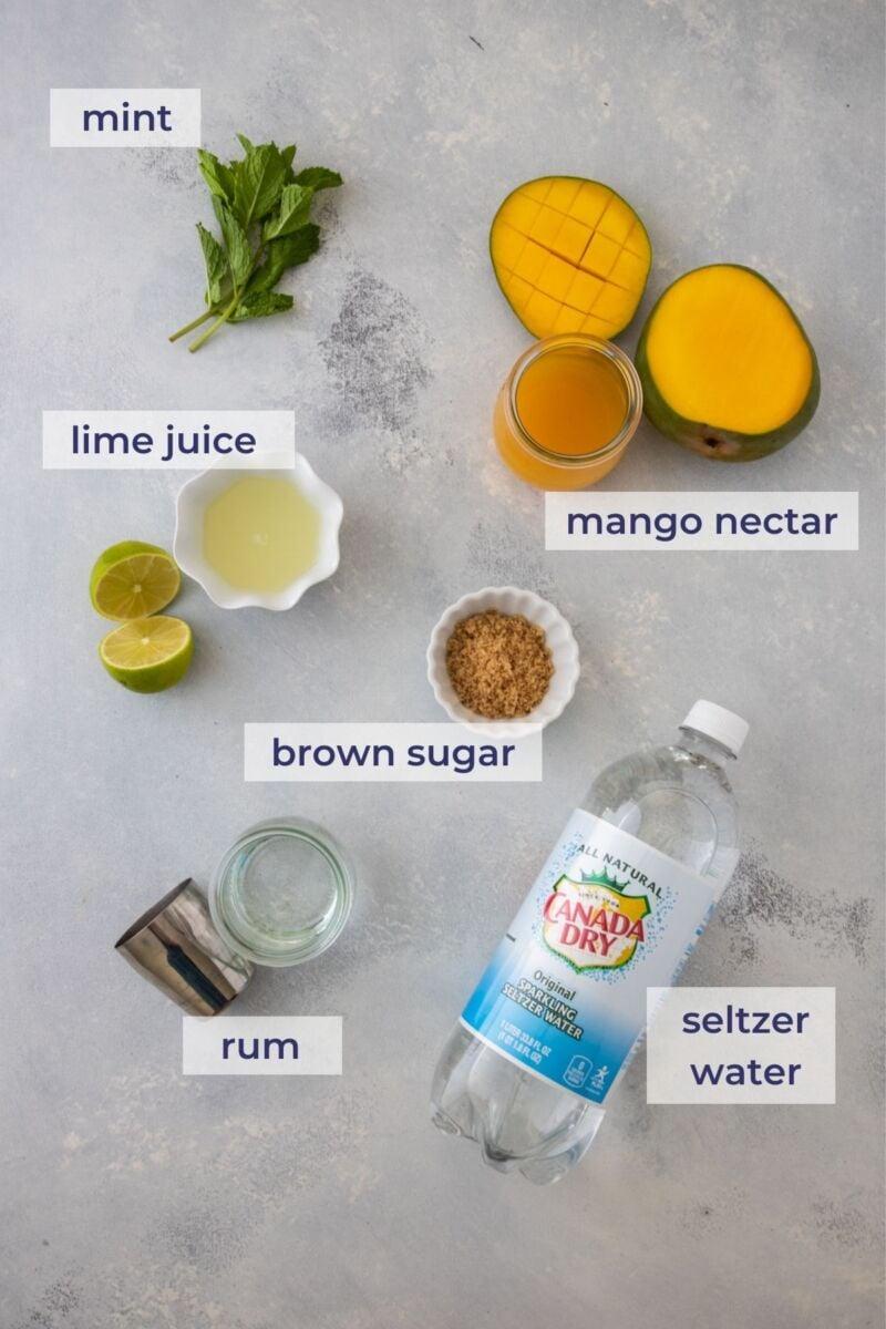 mango mojito ingredients in a board