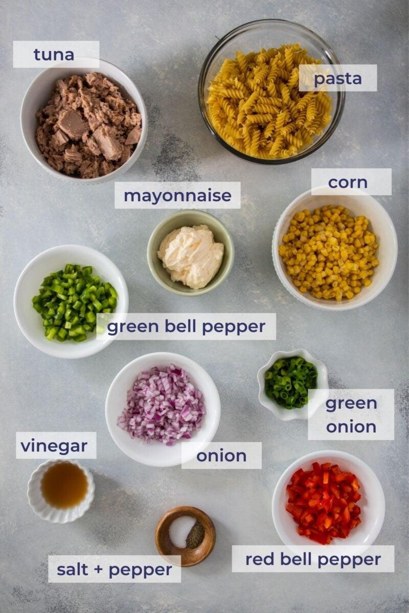 Tuna pasta salad ingredients on a board