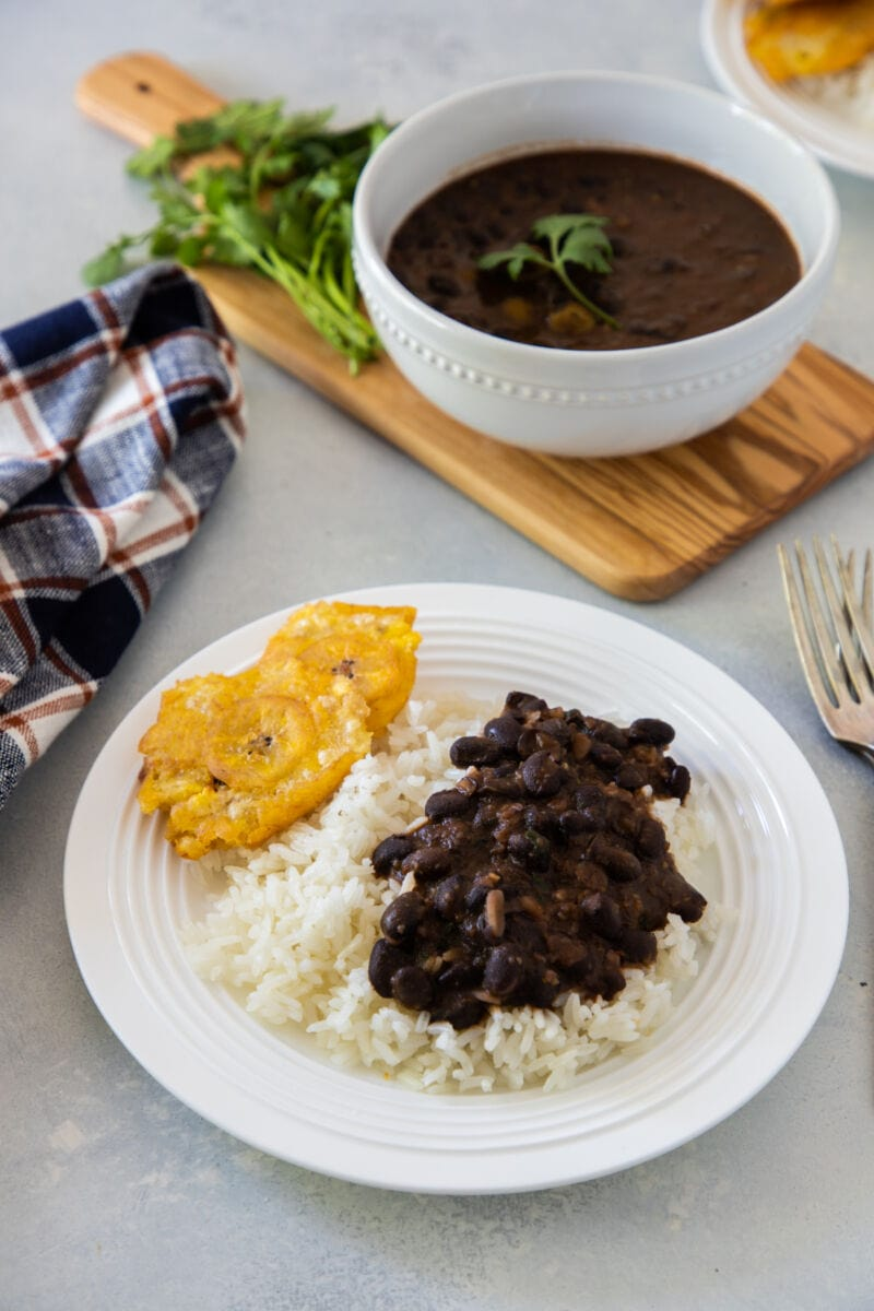Black bean stew served with rice and tostones.