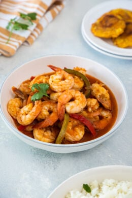 Shrimp stew served in a white bowl.