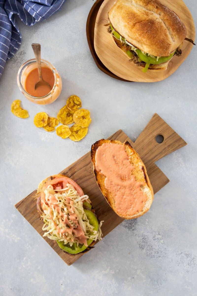 The sandwich de pierna toppings on an open bread roll.