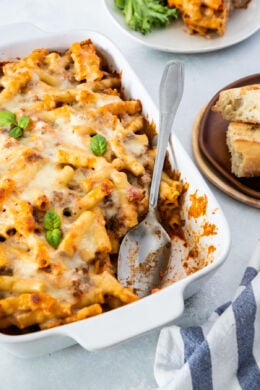 close up of ricotta baked ziti with serving spoon