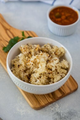 Pegao rice served in a white bowl.