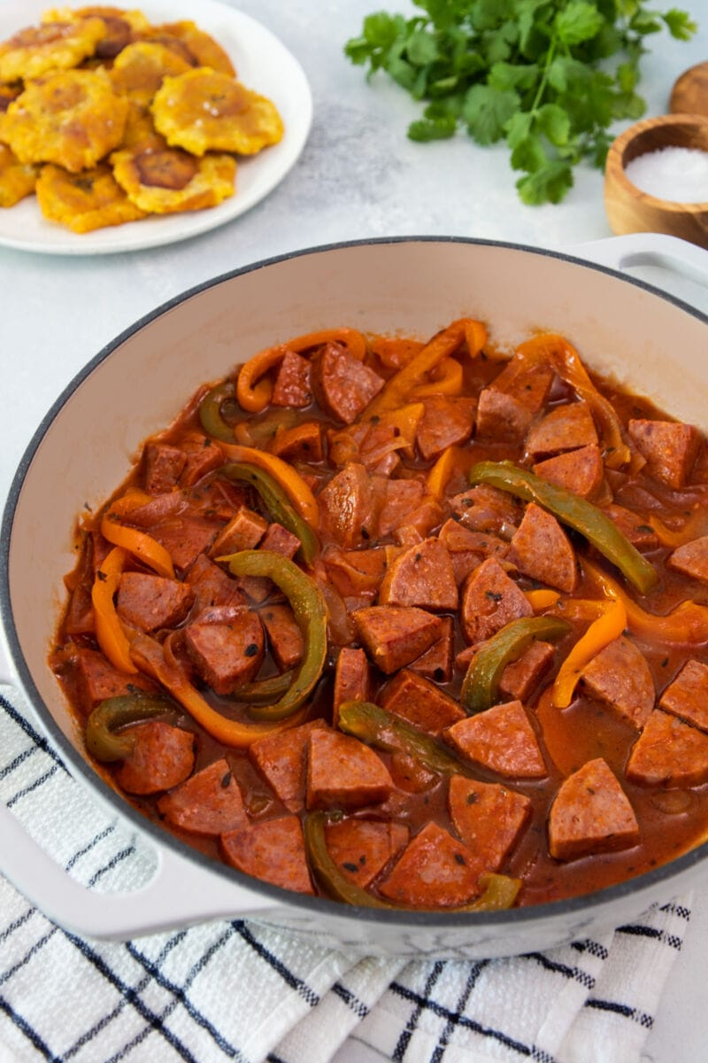 Dominican stewed salami in a serving bowl.